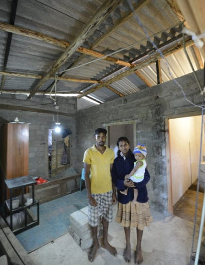 Family-standing-in-their-new-improved-home-683x1024