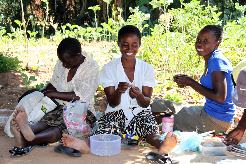 Women from the Vugani Project making beads from recycled paper, Zambia