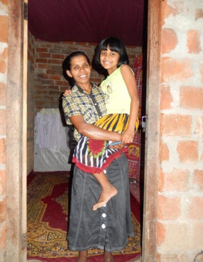 Mother-and-daughter-selected-as-recipients-for-house-repair-and-improvement-work.-768x1024