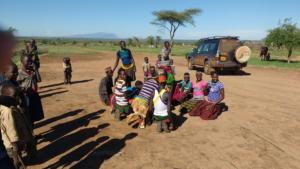 Tourists interacting with local community, Uganda